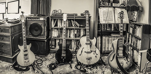 Image showing four of Esmond Selwyn's guitars.